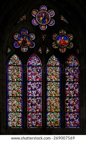 LEON, SPAIN - MAR 23, 2015: Medieval stained glass with floral details, made with techniques leaded, in the cathedral of Leon, Castille and Leon, Spain.