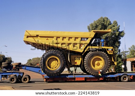 LEONORA, AUSTRALIA - MAY 11: transporting a large dumper truck on a road in downtown leonora in Western Australia, may 11, 2007.  - stock photo