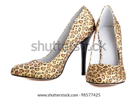 leopard  print shoes on lady isolated on white - stock photo