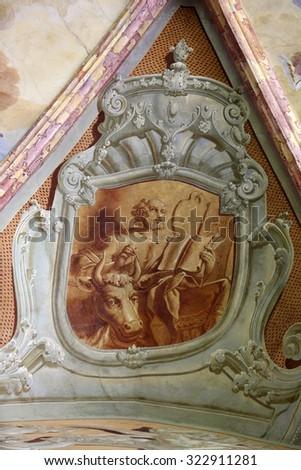 LEPOGLAVA, CROATIA - SEPTEMBER 21: Saint Luke the Evangelist, fresco in parish Church of the Immaculate Conception of the Virgin Mary in Lepoglava, Croatia on September 21, 2014 - stock photo