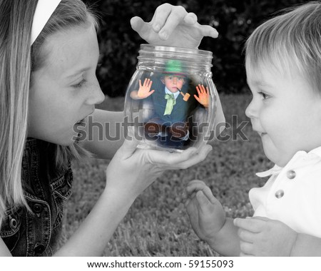 Leprechaun Caught in a jar - stock photo