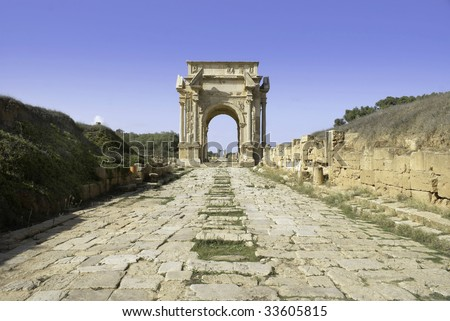 Leptis Magna, Libya. Roman Cobbled road leading to the Arch of Septimius Severus. - stock photo
