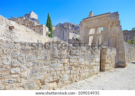 Les Baux de Provence ancient village, old stone wall and ruins on a street. France, Europe. - stock photo