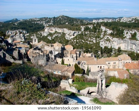 Les Baux-de-Provence is a small village near Saint Remy, In Provence, France.  It has a spectacular position in the Alpilles mountains, set atop a rocky outcrop crowned with a ruined castle. - stock photo