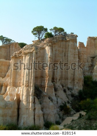 Les Orgues d'illes sur Tet, eroded organpipe shapes in sandstone formed many centuries ago. The shapes will eventually fade away.