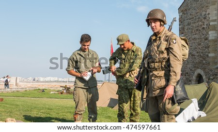"Les Sables d'Olonne, France - August 26, 2016: commemoration of the Liberation of ""Les Sables d'Olonne"", which took place on the night of August 27 to 28, 1944 - American and Russian soldiers relaxing"