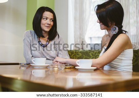lesbian couple girls drinking coffee - stock photo