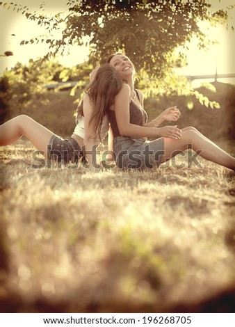 lesbian couple in nature  - stock photo