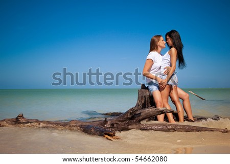 Lesbian couple on vacation - stock photo