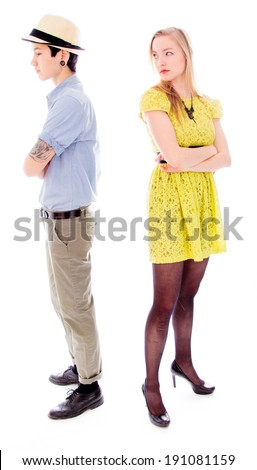 Lesbian couple standing back to back - stock photo
