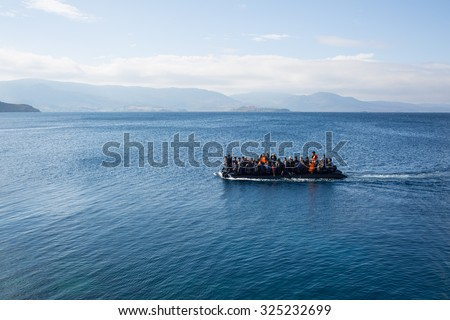 Lesbos, Greece - September 30, 2015: Refugees arrive on the boat from Turkey - stock photo
