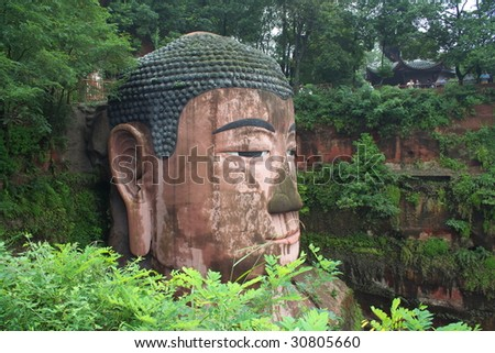 Leshan Grand Buddha is a famous cultural and historical spot in Sichuan Leshan, China, which is the world's biggest stone sitting buddha statue. - stock photo