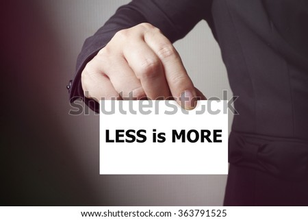 LESS IS MORE paper on the card , business concept , business idea