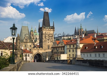 Lesser Town Bridge Towers from Charles Bridge with Prague Castle in the background - stock photo