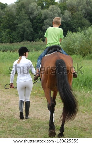 Lesson with Riding Instructor - stock photo