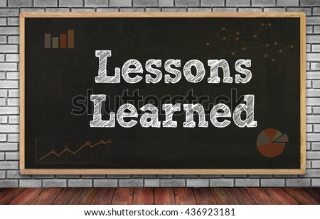 Lessons Learned on brick wall and chalkboard background