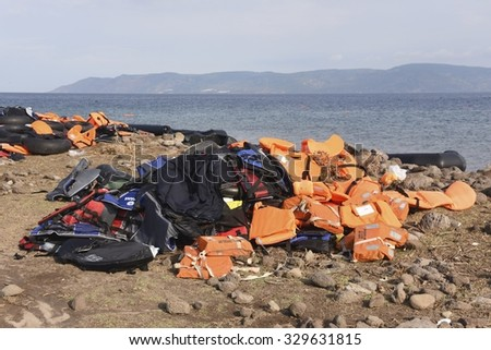 LESVOS, GREECE SEPTEMBER 24, 2015: Lifejackets and rubber rings discarded on a beach near Molyvos. Lesvos has been a hot spot for migrants and refugees arriving in inflatable boats from Turkey.