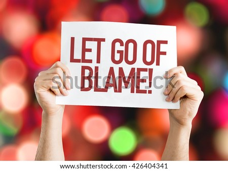 Let Go Of Blame placard with bokeh background - stock photo