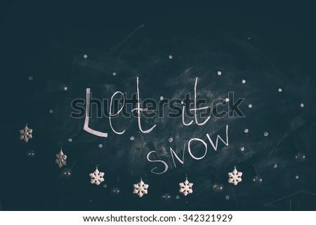 Let it snow! Christmas calligraphy. Handwritten modern brush lettering. Hand drawn design elements. - stock photo