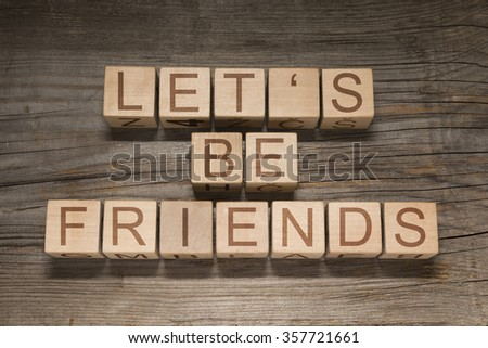 Let's be friends text on a wooden cubes - stock photo