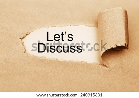Let's Discuss phrase written behind a torn paper - stock photo