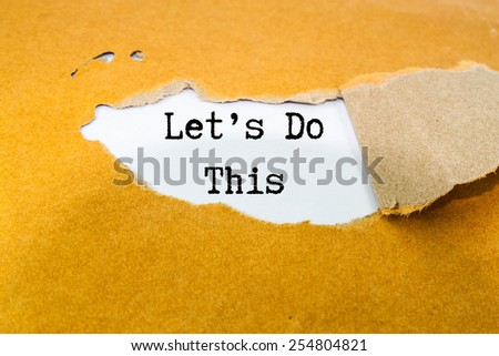 Let's Do This! Motivational slogan - stock photo