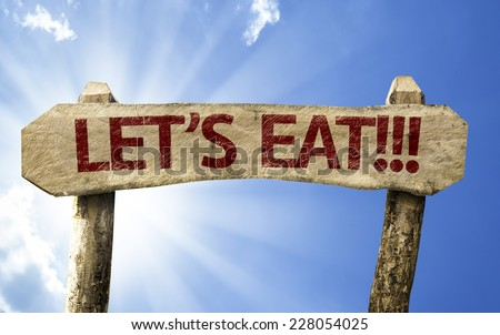 Let's Eat!! wooden sign on a summer day - stock photo