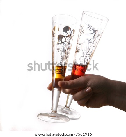 Let'S Get Some More Pair of red and gold champagne flutes almost empty held by hand. Isolated on white space (for text).