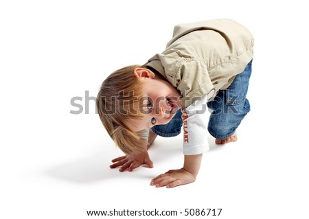 Let's play! Cute 3-years old playful boy isolated on white background. - stock photo