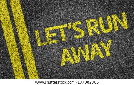 Let's Run Away written on the road - stock photo
