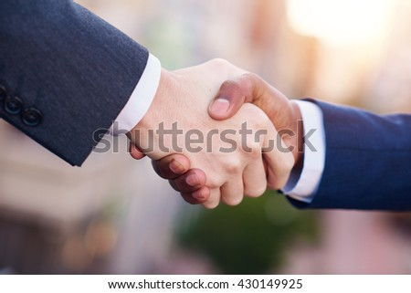Let's shake on the business deal - stock photo