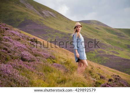 let's travel with me -  Walk in the heather blossom mountains in Scotland. - stock photo