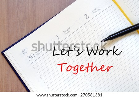 Let's work together concept Notepad - stock photo
