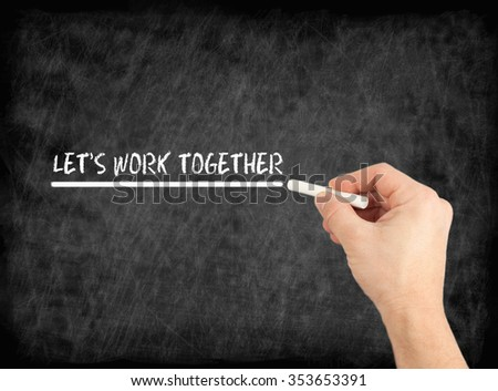 Let's work together - hand writing text on chalkboard
