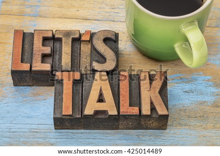 Let us talk invitation  - text in vintage letterpress wood type block with a cup of coffee - stock photo