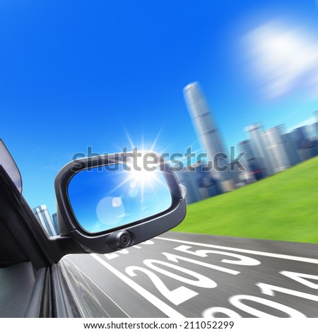 lets go new year drive to city car and rear view mirror on