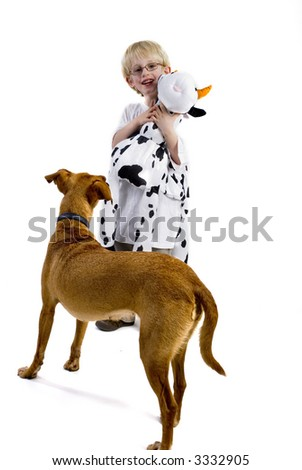 Lets play together with my toy-cow at sleeping-time - stock photo