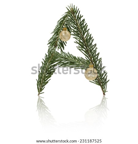 Letter A made from fir branches, decorated with christmas balls and reflection. - stock photo