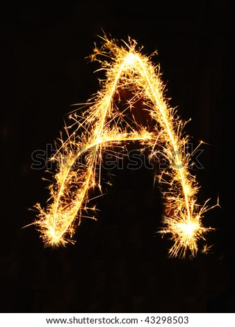 Letter A made of sparklers isolated on black - stock photo