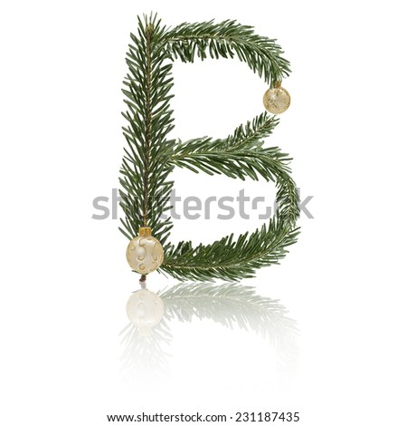 Letter B made from fir branches, decorated with christmas balls and reflection. - stock photo