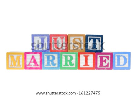 Letter blocks spelling just married isolated on a white background - stock photo