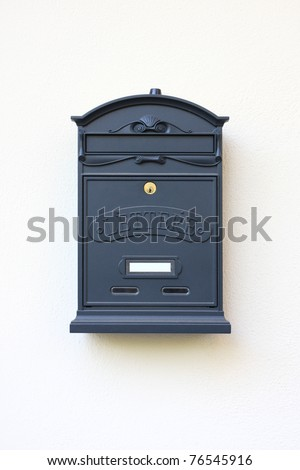 letter-box on a white wall - stock photo