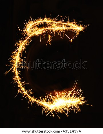 Letter C made of sparklers isolated on black - stock photo