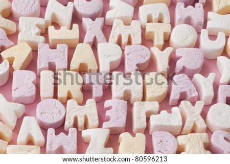 Letter candies spelling out the words Happy Birthday - stock photo