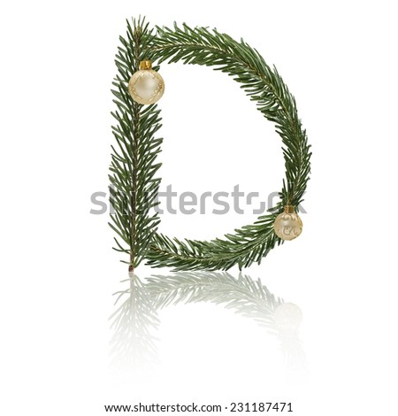 Letter D made from fir branches, decorated with christmas balls and reflection. - stock photo
