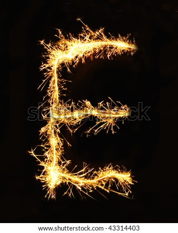Letter E made of sparklers isolated on black - stock photo