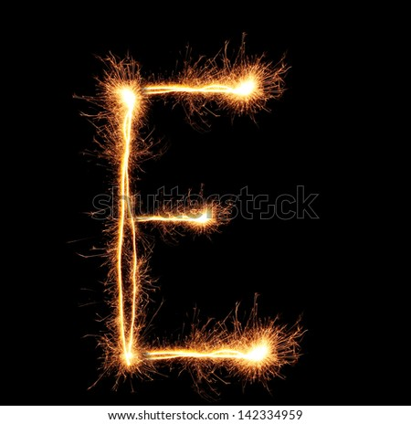 "Letter ""E"" sparklers on black background - stock photo"