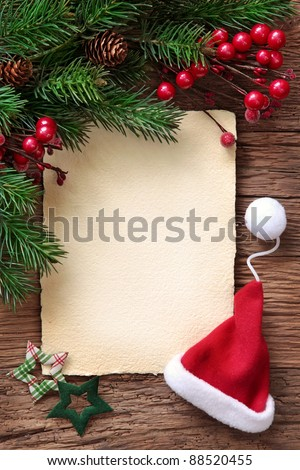 Letter for santa with old parchment and santa hat - stock photo