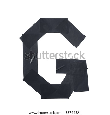 Letter G symbol made of insulating tape pieces, isolated over the white background - stock photo