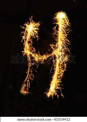 Letter H made of sparklers isolated on black - stock photo
